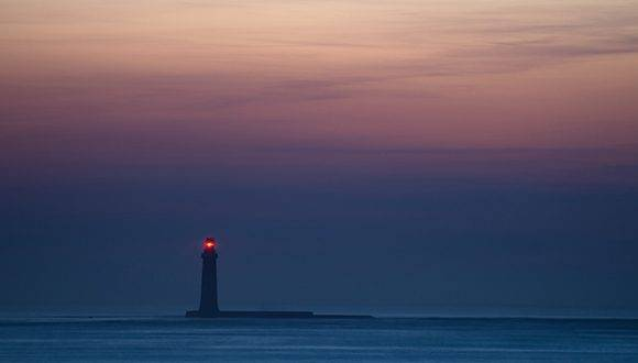 "A picture taken on January 24, 2017 shows the ""barges"" lighthouse off Les Sables d'Olonne, western France. / AFP PHOTO / JEAN-SEBASTIEN EVRARD"