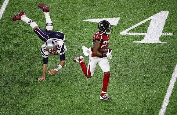 HOUSTON, TX - FEBRUARY 05:  Tom Brady #12 of the New England Patriots attempts to tackle Patrick Chung #23 of the New England Patriots after an interception in the second quarter during Super Bowl 51 at NRG Stadium on February 5, 2017 in Houston, Texas.  (Photo by Ezra Shaw/Getty Images)