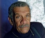 2000:  Studio headshot portrait of St. Lucian-born poet and dramatist Derek Walcott wearing a black jacket and a black turtleneck. Walcott won the Nobel Prize in 1992.  (Photo by Horst Tappe/Hulton Archive/Getty Images)