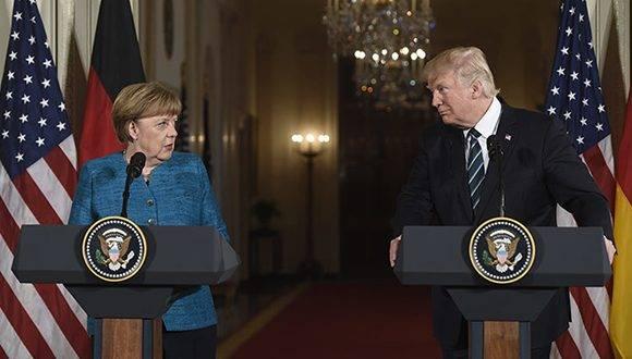 Donald Trump y Angela Merkel en conferencia de prensa en la Casa Blanca. Foto: AFP.