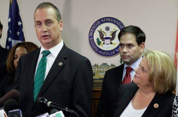 Rep. Mario Diaz-Balart, (R-FL), (L), speaks next to Senator Marco Rubio, (R-FL), and Rep. Ileana Ros-Lehtinen, (R-FL),  during a press conference in Miami, Florida December 18, 2014.   REUTERS/Javier Galeano