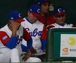 Los rostros de la dirección cubana durante la abultada derrota ante Holanda. Foto: Ricardo López Hevia/ Granma/ Cubadebate.