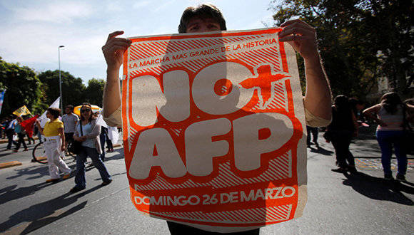 A demonstrator holds a banner during a march against the national pension system, in Santiago, Chile March 26, 2017. REUTERS/Carlos Vera EDITORIAL USE ONLY. NO RESALES. NO ARCHIVE