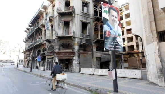 Imagen del rpesidente sirio, Bashar Al-Assad, en la ciudad siria de Homs, antigua capital de los opositores armados. Foto: Reuters.