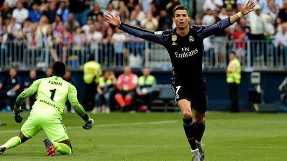 Cristiano abrió el marcador ante el Málaga en el minuto 2' y encarriló el partido para ganar La Liga. Foto: AFP.