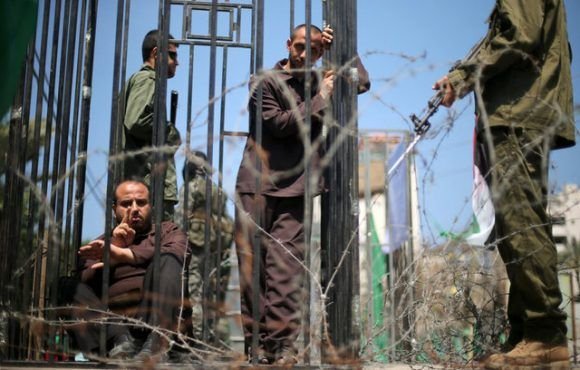 Men play the role of jailed Palestinians and Israeli soldiers during a rally in support of Palestinian prisoners on hunger strike in Israeli jails, in Gaza City April 17, 2017. REUTERS/Mohammed Salem