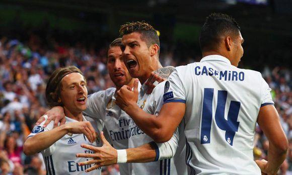 Cristiano celebra eufórico junto a sus compañeros luego de anotarle al Atlético, lleva 22 tantos contra el conjunto colchonero. Foto: Getty Images.