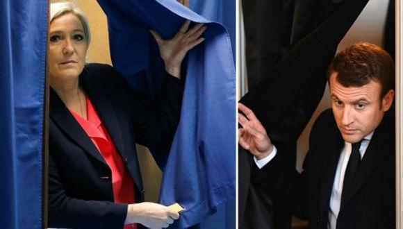 Emmanuel Macron y Marine Le Pen, depositaron sus votos sin hacer declaraciones a la prensa. Foto: Reuters/ AFP.