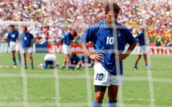 FILE - In this July 17, 1994 file photo, Roberto Baggio of Italy looks disappointed after Brazilian goalkeeper Taffarel saved his penalty shot, during the World Cup Final, in Pasadena, Ca., USA. (AP Photo/Luca Bruno, File)