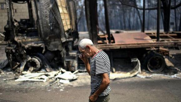 Al menos 20 poblaciones fueron afectadas por el incendio, dicen las autoridades. Foto: AFP.