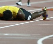Athletics - World Athletics Championships – men's 4 x 100 meters relay final – London Stadium, London, Britain – August 12, 2017 – Usain Bolt of Jamaica lays on the track after sustaining an injury. REUTERS/Lucy Nicholson