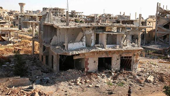 Así ha quedado la ciudad de Deraa luego del destrozo ocasionado por grupos terroristas financiados por las potencias occidentales para provocar la caída del presidente Bashar al-Ásad. Foto: Reuters.