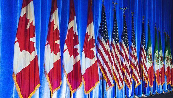 Banderas de México, Estados Unidos y Canadá, países integrantes del TLCAN. Foto: AFP.