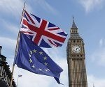 A European and a Union flag fly alongside Big Ben during an Anti Brexit campaigners march in Parliament in London, Saturday March 25, 2017. Britain's Prime Minister Theresa May is expected to start the process of leaving the European Union on Wednesday March 29. (AP Photo/Kirsty Wigglesworth)