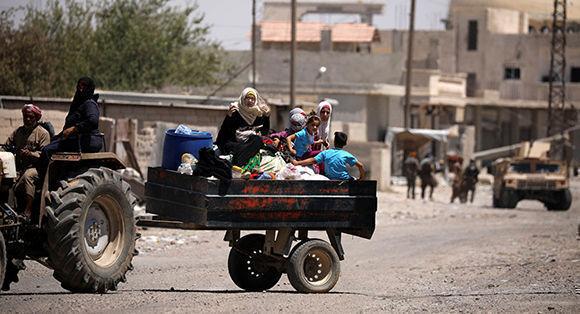 La mitad de los desplazados residentes en centros de alojamiento regresó a sus hogares en Siria. Foto: Sputnik.