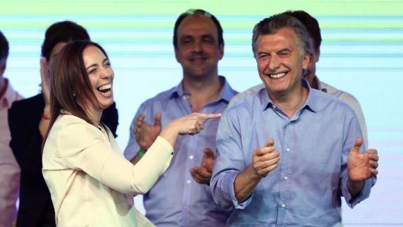 Argentina's President Mauricio Macri and Buenos Aires' governor Maria Eugenia Vidal laugh at their campaign headquarters in Buenos Aires, Argentina October 22, 2017. REUTERS/Marcos Brindicci - RC18000FA810