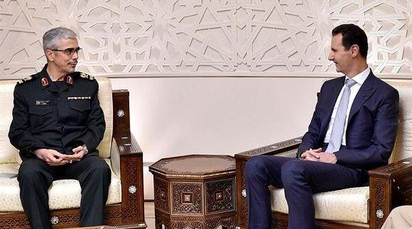 El presidente sirio, Bachar Al-Assad, durante su reunión con el jefe del Estado Mayor iraní, Mohamed Husein Bagheri. Foto: SANA.