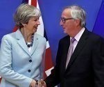 Britain's Prime Minister Theresa May is welcomed by European Commission President Jean-Claude Juncker at the EC headquarters in Brussels