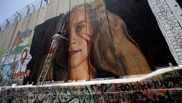 El mural de Tamimi pintado en el muro israel