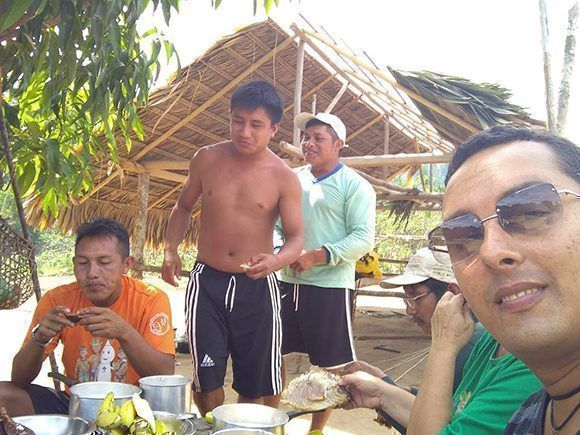 Arnaldo Cedeño Núñez shares in the village with his patients. Photo: Courtesy of Dr. Arnaldo Cedeño Núñez.
